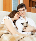 Loving young couple with kitten Stock Image
