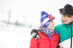 Loving young couple looking at each other in snow Stock Photography