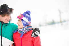 Loving young couple looking at each other in snow Royalty Free Stock Photos