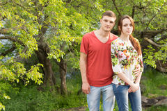 Loving young couple in lush woodland Royalty Free Stock Photo