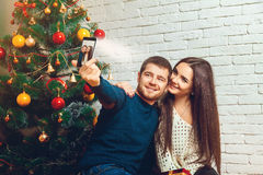 Loving young couple making Christmas selfie Royalty Free Stock Photography