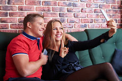 Loving young couple is making selfie using a smartphone smiling Stock Photo