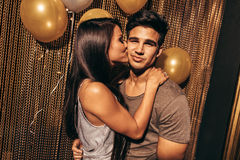 Loving young couple in the night club royalty free stock photography