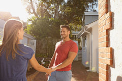 Loving young couple outdoors in their backyard Stock Photos