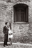 Loving young couple outside an old brick building Stock Image