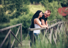 Loving young couple in park Royalty Free Stock Image