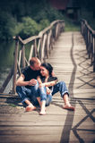 Loving young couple in park Stock Photos