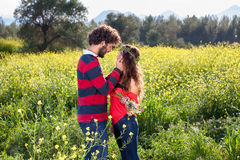 Loving young couple in a rapeseed field. Stock Photography