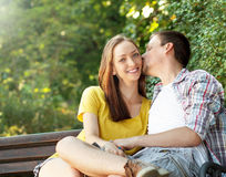 Loving young couple relaxing in park Stock Photography