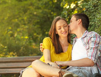 Loving young couple relaxing in park Stock Images