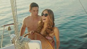 Loving young couple relaxing on a yacht. Love story. Loving young couple relaxing on a yacht. Just Married traveling on a yacht. Guy and a girl went to a sea stock video