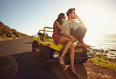 Loving young couple on road trip Royalty Free Stock Image