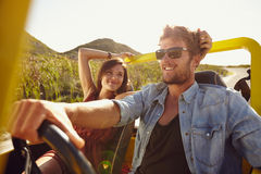 Loving young couple on road trip stock photography