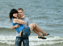 Loving young couple at sea Royalty Free Stock Photos