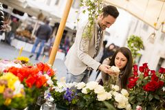 Loving couple smelling roses in Rome, Italy