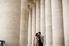 Loving couple at the St. Peter`s Square in Vatican