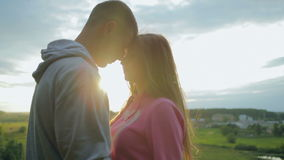 Loving young couple in sunlight stock video