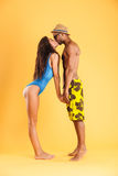 Loving young couple in swimwear kissing Stock Photos