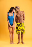 Loving young couple in swimwear kissing Royalty Free Stock Photo