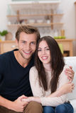 Loving young couple in their living room Stock Photography