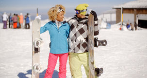 Loving young couple with their snowboards Royalty Free Stock Photo