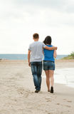 Loving young couple is walking at sea Royalty Free Stock Photos