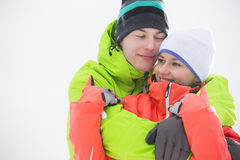 Loving young couple in warm clothing embracing outdoors Royalty Free Stock Photo
