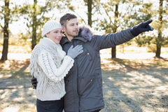Loving young couple in winter clothing in the woods Royalty Free Stock Photography