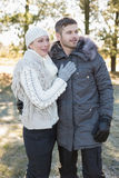 Loving young couple in winter clothing in the woods Stock Photography