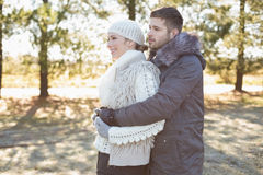 Loving young couple in winter clothing in the woods Stock Image