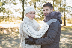Loving young couple in winter clothing in the woods Stock Photos