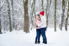 Young couple in winter forest stock images