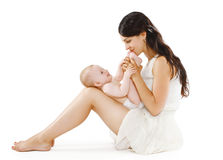 Loving  young mother kissing feet her baby Stock Photos