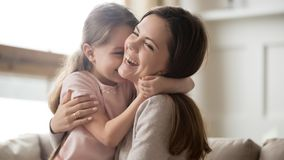 Loving young mother laughing embracing smiling cute funny kid girl. Loving young mother laughing embracing smiling cute funny kid daughter enjoying time together stock image