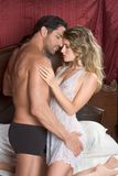 Loving young nude erotic sensual couple in bed Stock Photo