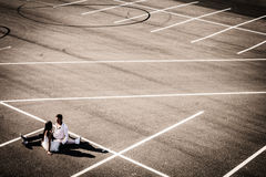 Loving young pair at wedding on an empty autoparking Royalty Free Stock Photography