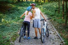 Loving young people met in the park. Ride on bicycles. The conce Royalty Free Stock Photography