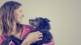 Loving young woman with her pet dog Royalty Free Stock Photos