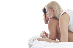 Loving young woman on man in hotel room Royalty Free Stock Photo