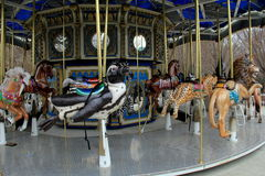 Lovingly crafted Carousel ride with intricate detail of wildlife,Baltimore Zoo,Maryland,2015. Intricate detail of wildlife animals on lovingly crafted Carousel Royalty Free Stock Image