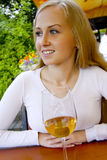 Lovly woman with a glass of wine. Royalty Free Stock Photo