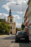 Lovosice, Czech republic - September 08, 2018: black car Opel Astra parked in Osvoboditelu street with Kostel Svateho Vaclava chur. Ch on background during noon royalty free stock photo