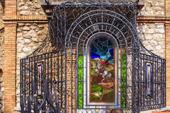 Lovran, Croatia. Beautiful villas with lush greenery in the resort Lovran, Istria, Croatia. Lovran was and is a favorite spa.Here a detail of a stained glass Royalty Free Stock Photos