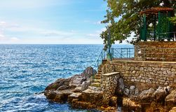 Lovran, Croatia. Rocky stone coastline with big royalty free stock photos
