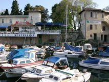 Lovran harbour with motor boats and restaurant Kvarner in Lovran,Croatia Royalty Free Stock Image