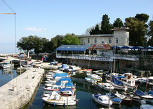 Lovran harbour with motor boats and restaurant Kvarner in Lovran,Croatia Stock Images