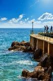 Lovran, Istria, Croatia. Adriatic Sea embankment. Lovran, Istria, Croatia. Picturesque embankment along resort old town at coast of Adriatic Sea with blue water stock photos