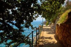 Lovran, Istria, Croatia. Adriatic Sea embankment. Lovran, Istria, Croatia. Picturesque embankment along resort old town at coast of Adriatic Sea with blue water stock images
