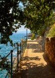 Lovran, Istria, Croatia. Adriatic Sea embankment. Lovran, Istria, Croatia. Picturesque embankment along resort old town at coast of Adriatic Sea with blue water stock photography