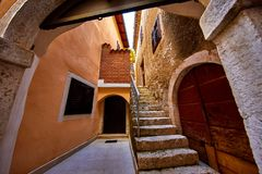 Lovran, Istria, Croatia. Vintage medieval buildings. And houses at narrow lanes of old town. Stone stairs, wooden doors and windows. Decorative arch between royalty free stock photos